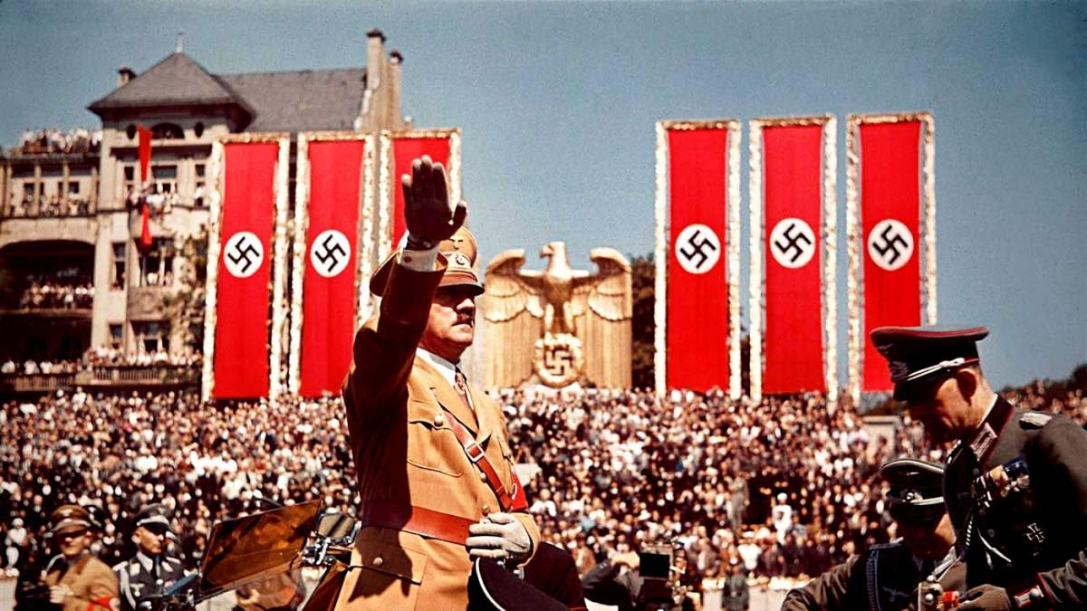 https://im1.7job.gr/sites/default/files/imagecache/1200x675/article/2018/43/276337-adolf_hitler_salutes_troops_of_the_condor_legion_who_fought_alongside_spanish_nationalists_in_the_spanish_civil_war_during_a_rally_upon_their_return_to_germany_1939..jpg